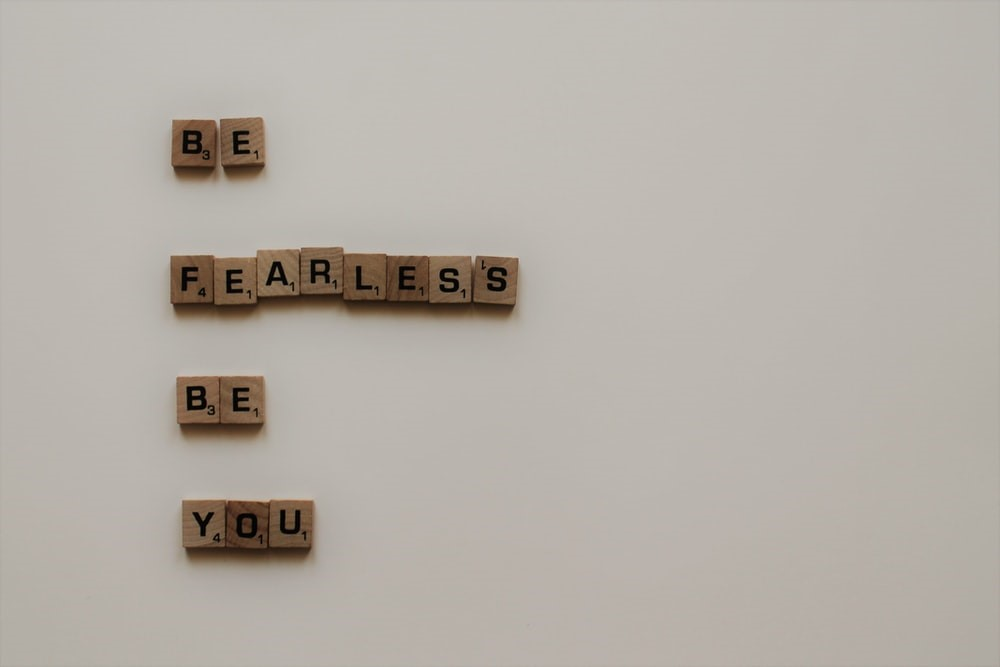 scrabble words arranged to say believe in yourself